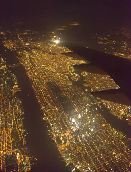 Electricity Generation Photograph - Manhattan Island At Night, Aerial, New by Eastcott Momatiuk