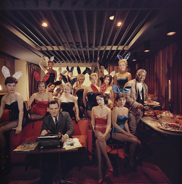 Hugh Hefner Photograph - Mans Work by Slim Aarons