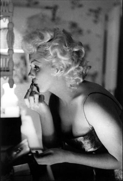 Marilyn Monroe Photograph - Marilyn Getting Ready To Go Out by Michael Ochs Archives