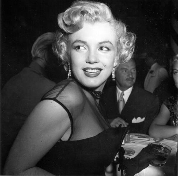 Marilyn Monroe Photograph - Marilyn Monroe At A Banquet by Michael Ochs Archives