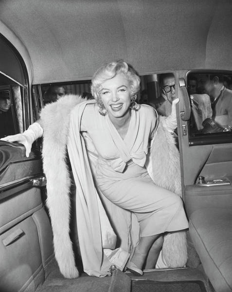 Photograph - Marilyn Monroe Boarding A Car by Bettmann