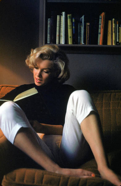 Human Interest Photograph - Marilyn Monroe Reading At Home by Alfred Eisenstaedt