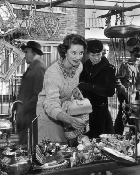 Merchandise Photograph - Market Shopper by Evening Standard