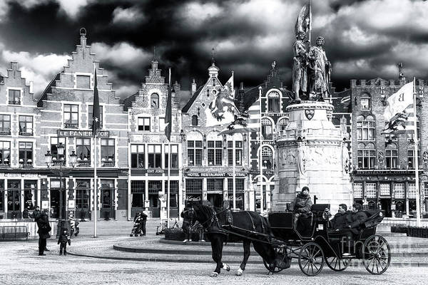 Wall Art - Photograph - Market Square Drama In Bruges by John Rizzuto