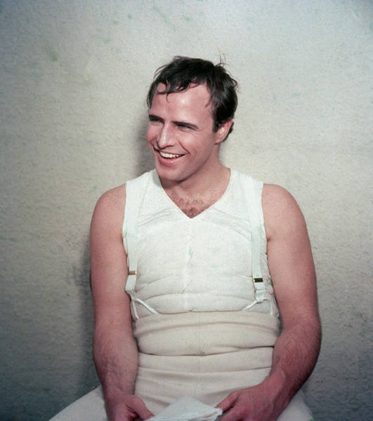 Laughing Photograph - Marlon Brando Laughing On Film Set by Hulton Archive