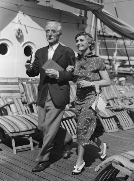 Boat Deck Photograph - Mature Couple On Deck Of Boat by George Marks