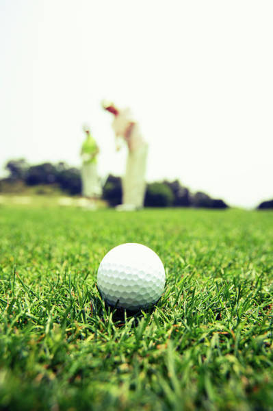 Golf Photograph - Mature Couple Playing Golf by Bloom Image