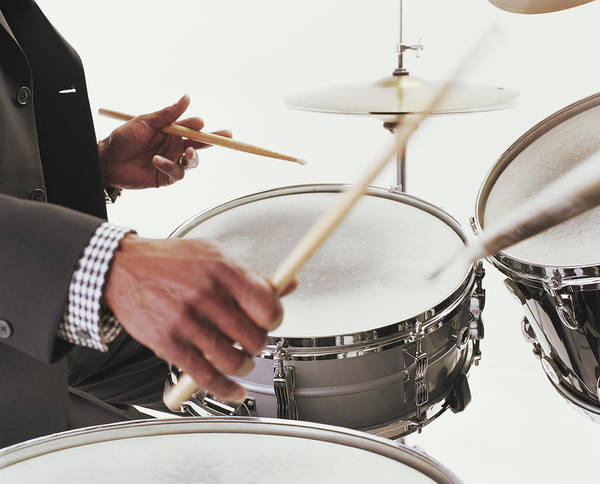 Human Hand Photograph - Mature Man Playing Drums, Close-up Of by Ryan Mcvay