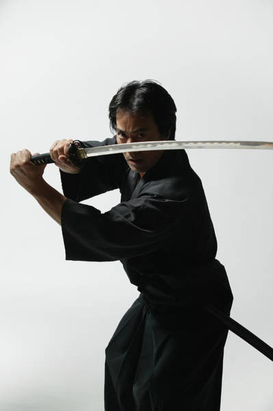 Wall Art - Photograph - Mature Man With Sword In Combat Stance by Hisayoshi Osawa