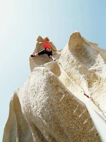 Caucasian Photograph - Mature Woman Climbing Overhanging by Ascent/pks Media Inc.