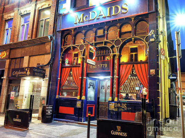 Wall Art - Photograph - Mcdaids At Night In Dublin by John Rizzuto