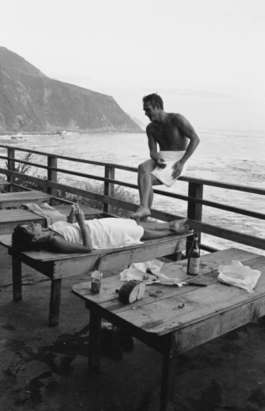 Steve Mcqueen Photograph - Mcqueen & Adams Relax In Big Sur by John Dominis