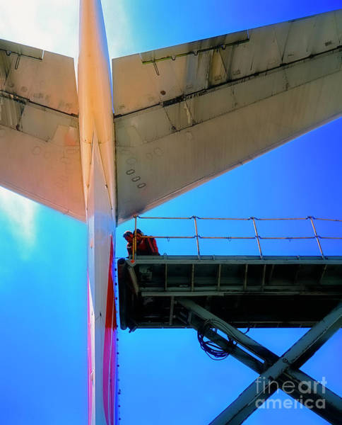 Photograph - Mechanics Working On The Tail Of A Commercial Airliner  by Tom Jelen