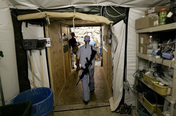 Rifle Photograph - Medical Personnel At Balad Trauma by Chris Hondros