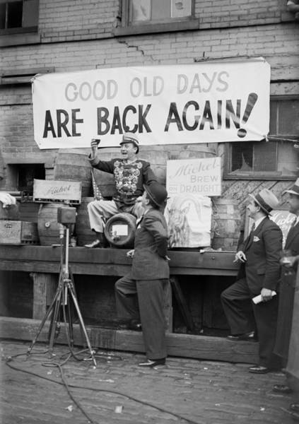 Photograph - Men Celebrate Newly Reopened Brewery by Bettmann