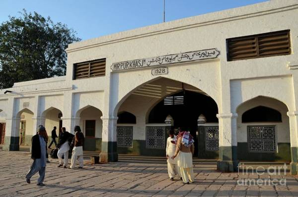 Photograph - Men In Pakistani Dress Gather Under Arch Of Colonial Mirpurkhas Junction Station Sindh Pakistan by Imran Ahmed