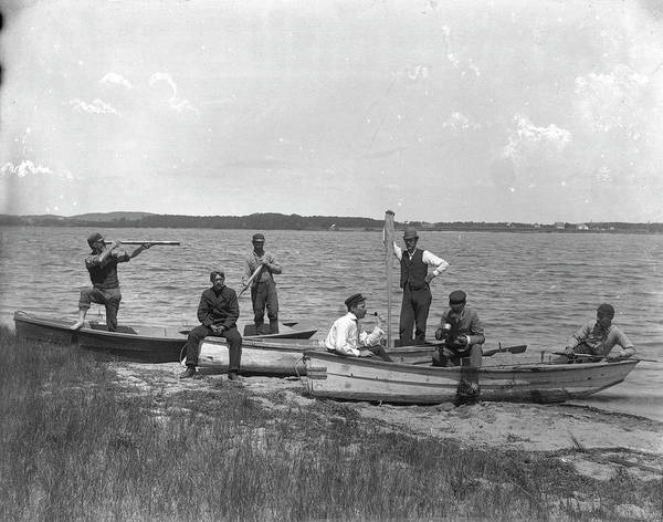 Rowboat Photograph - Men In Rowboats On A Narrow Beach By A by The New York Historical Society