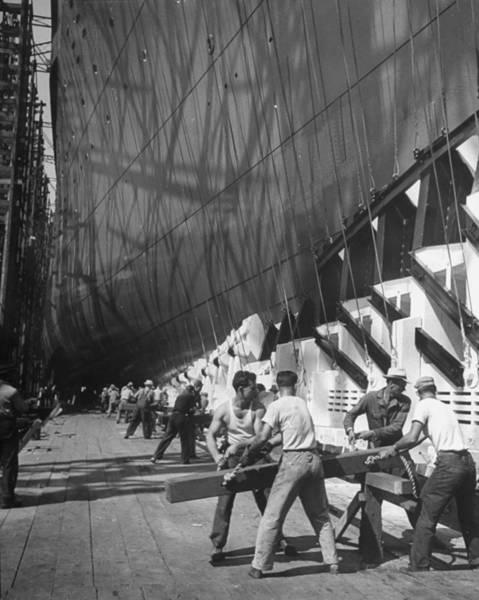 Photograph - Men Preparing To Launch Ocean Liner Amer by Alfred Eisenstaedt