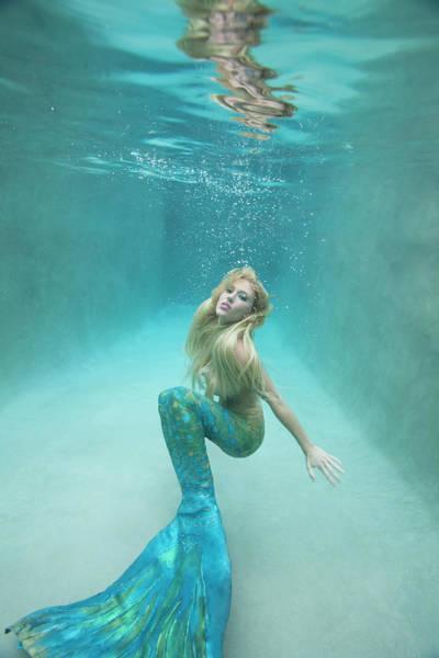 Underwater Camera Photograph - Mermaid Swimming Under Water by Ariel Skelley