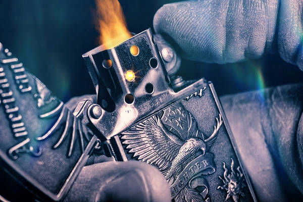 Flammable Wall Art - Photograph - Metal Lighter In Hand by ENZO Art in photography