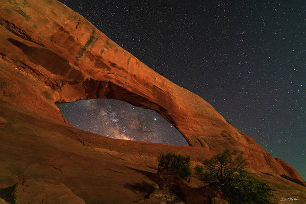 Photograph - Milky Way Framed By Wilson Arch by Dan Norris