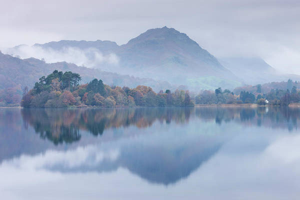 Mist Hangs Over The Lake And Island At Art Print