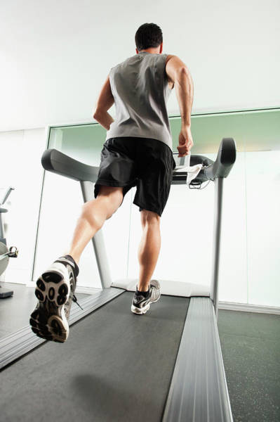 Improvement Photograph - Mixed Race Man Running On Treadmill by Erik Isakson