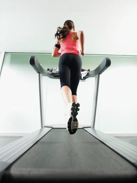 Improvement Photograph - Mixed Race Woman Running On Treadmill by Blend Images - Erik Isakson