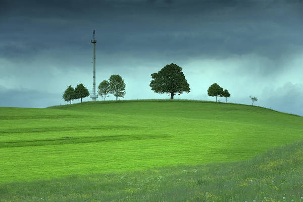 Wall Art - Photograph - Mobile Phone Antennae On A Green Field by Bkindler