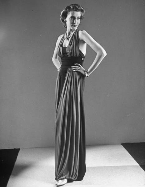 Neiman Photograph - Model Clad In A Two-toned, Harem-hemline by Alfred Eisenstaedt