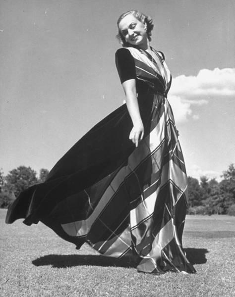 Neiman Photograph - Model Clad In Elegant Velvet Housecoat W by Alfred Eisenstaedt