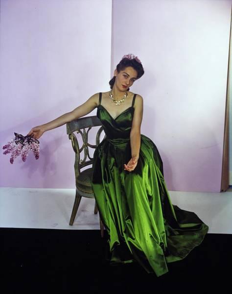 Purple Flower Photograph - Model In A Nettie Rosenstein Gown by Horst P. Horst