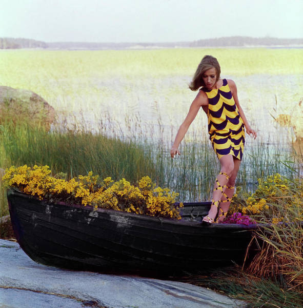 Photograph - Model In Rowboat Filled With Yellow Flowers by Gordon Parks