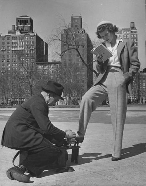 Model Showing Off Slacks As She Reads A Art Print by Nina Leen
