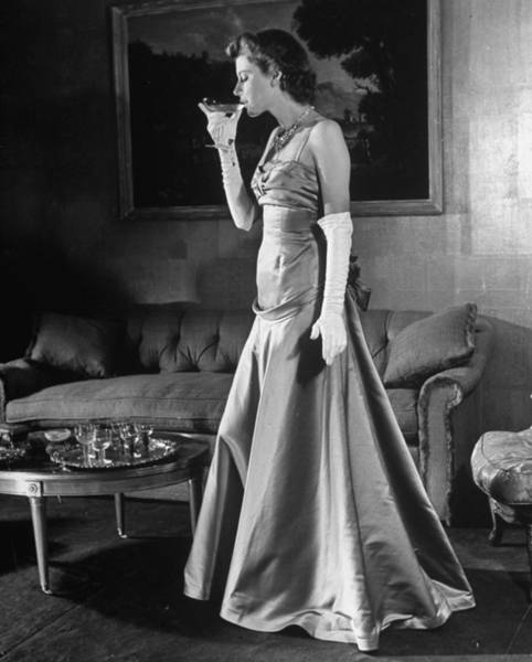 Neiman Photograph - Model Sporting Long White Gloves, Drinki by Alfred Eisenstaedt