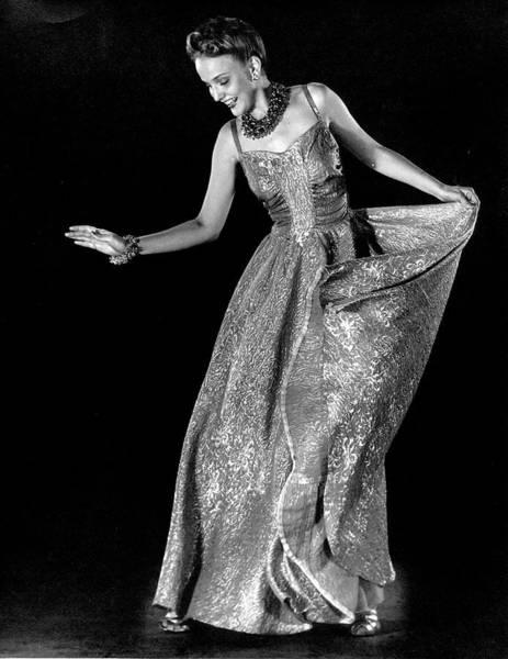 Brocade Photograph - Model Wearing Gold Brocade Evening Dress by Gjon Mili