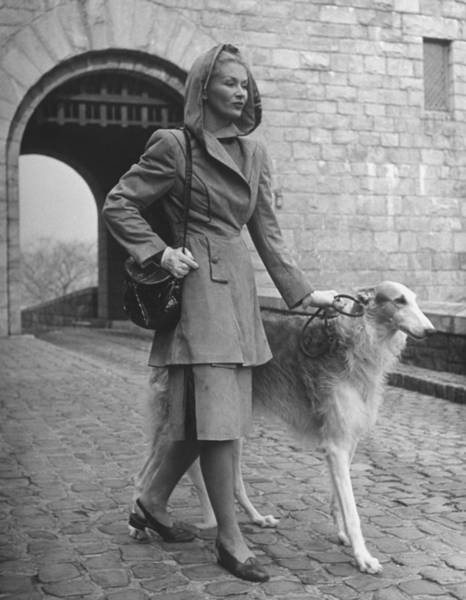 Suit Photograph - Model Wearing Hooded Suede Suit While Wa by Nina Leen
