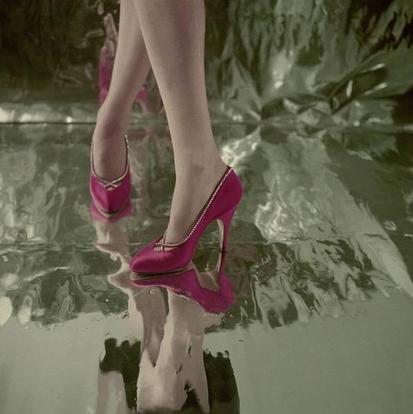Wall Art - Photograph - Model's Feet In Red Jordan Pumps by Henry Clarke
