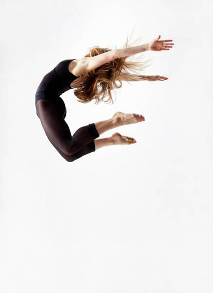 Human Arm Photograph - Modern Dancer Jumping In The Air by Jonya
