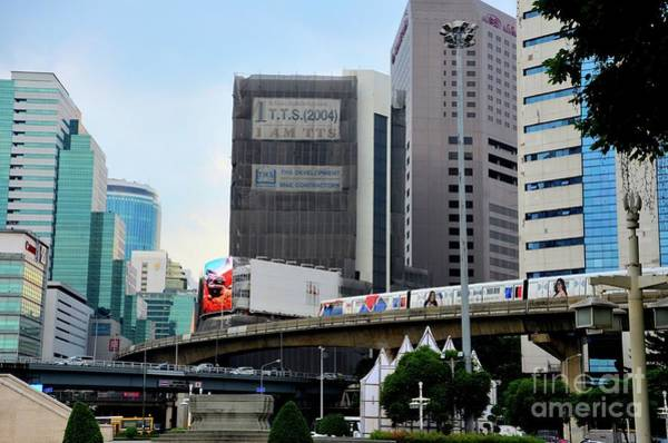 Photograph - Modern Urban Image With Bts Skytrain Transport And Skyrise Buildings Central Bangkok Thailand by Imran Ahmed