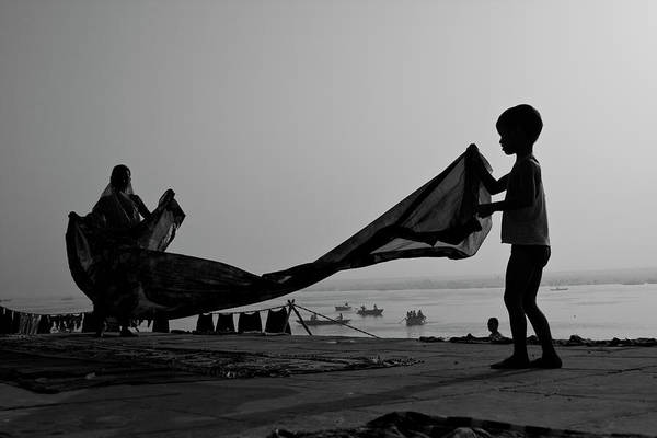 Ganges River Photograph - Mom And Son Are Waving Saree To Dry by The Pictorialist Ring