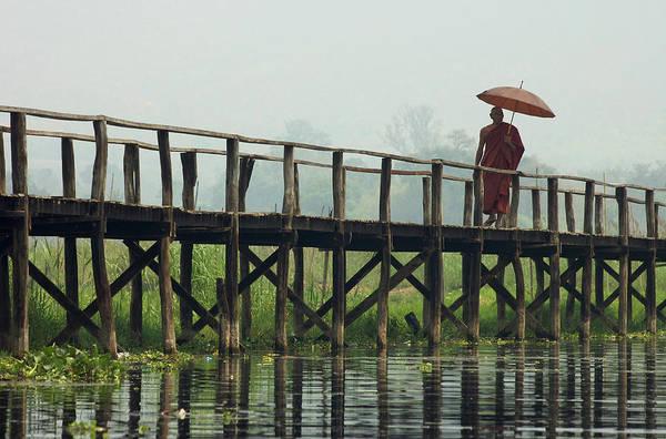 Lakeshore Photograph - Monk Crosses A Bridge On The Eastern by David Greedy