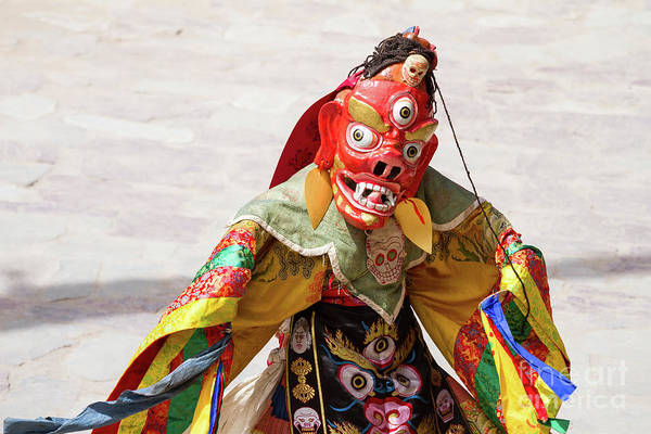 Wall Art - Photograph - Monk In Wrathful Deity Masks Performs A Cham Dance Of Tantric Tibetan Buddhism by Oleg Ivanov