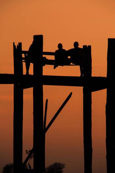 Resting Photograph - Monks Resting On Uben Bridge - Myanmar by Copyright Pascal Carrion