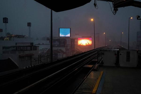 Blade Runner Photograph - Monsoon Rain Seen From A Bangkok Train Station by Ruben Vicente