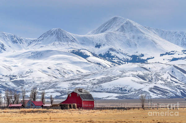 Farmhouse Wall Art - Photograph - Montana Farm Dwarfed By Tall Mountains by Mh Anderson Photography