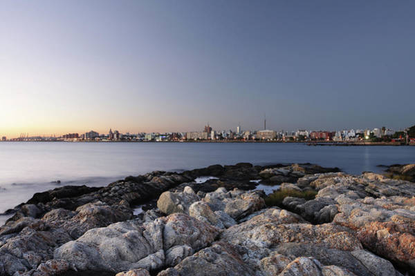 Montevideo Wall Art - Photograph - Montevideo City Scape With Rocks At The by Lucop