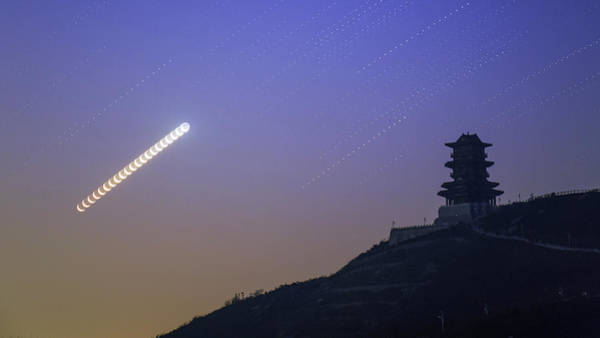 Wall Art - Photograph - Moon Trails Above Wangjing Tower by Jeff Dai