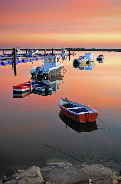 Moored Photograph - Moored Boats On Sea At Sunset by Juampiter