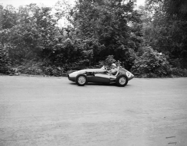 Motor Sport Photograph - Moss High On Bend by Evening Standard